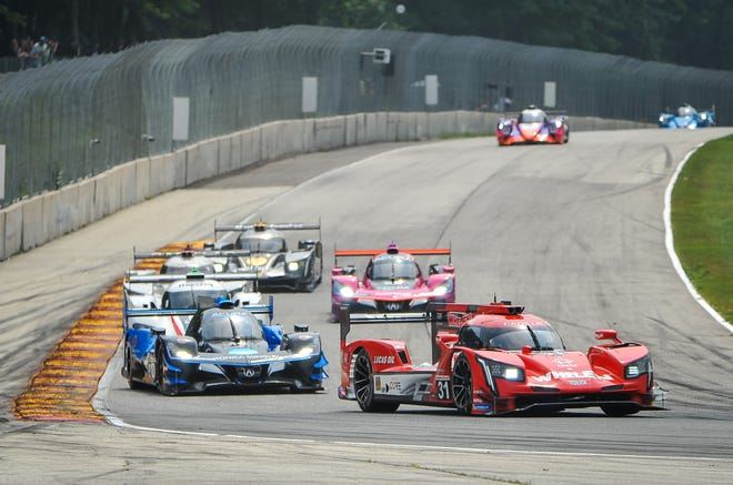Felipe Nasr leads the field into Turn 5 in the No. 31 Cadillac on the first lap of the IMSA SportsCar Weekend race Sunday at Road America. The track is scheduled to be repaved after next season.