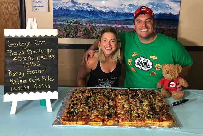 """In July of 2020, professional eaters Randy Santel and Katina DeJarnett met up in Alaska to do the """"Garbage Can"""" 40-inch team Pizza Challenge at Riverside Pizza in Nenana together."""