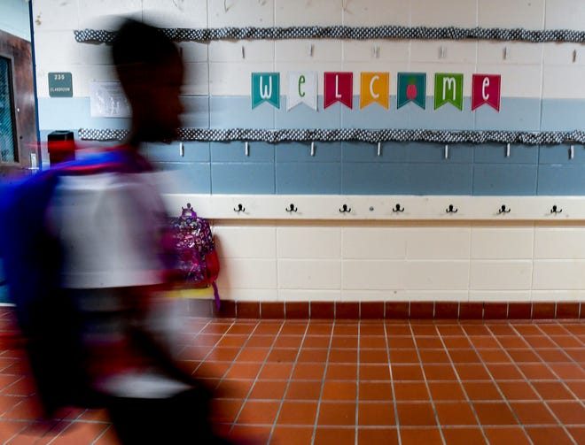 Students arrive for the first day of classes at Wetumpka Elementary School in Wetumpka, Ala., on Monday August 9, 2021.