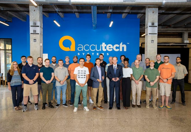 Ball State President Geoffrey S. Mearns (front row, fifth from right) presents the 2021 Ball State University Community Partner of the Year Award to Accutech President Adam Unger (front row, sixth from right).