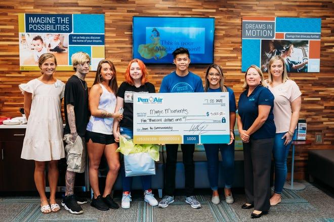 Pen Air donates $5,000 to Magic Moments through #JeansForCommunerosity.