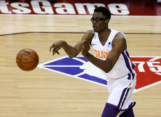 Jalen Smith #10 of the Phoenix Suns passes the ball up the court against the Los Angeles Lakers during the 2021 NBA Summer League at the Thomas & Mack Center on August 8, 2021 in Las Vegas, Nevada.