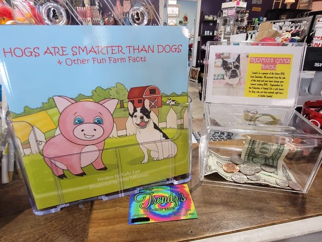 """People can buy a copy of """"Hogs are Smarter than Dogs: & Other Fun Farm Facts"""" at Trendz's at 5480 Main St. in Lexington."""