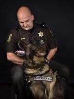 St. Clair County Sheriff police dog Fist with his handler, K9 Deputy Michael Pink.