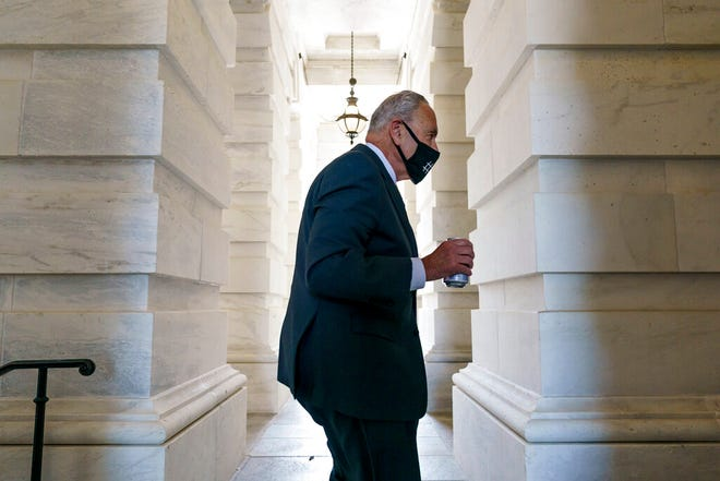 Senate Majority Leader Chuck Schumer, D-N.Y., arrives as senators convene for a rare weekend session to continue work on the $1 trillion bipartisan infrastructure bill, at the Capitol in Washington, Sunday, Aug. 8, 2021. (AP Photo/J. Scott Applewhite)