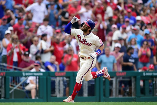 Philadelphia Phillies' Bryce Harper looks to the sky after hitting a solo home run off New York Mets starting pitcher Taijuan Walker during the sixth inning of a baseball game, Sunday, Aug. 8, 2021, in Philadelphia. (AP Photo/Derik Hamilton)
