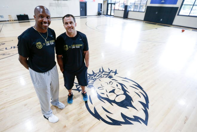 Adam Donyes (right) founded Link Academy and hired Rodney Perry to coach the basketball program.