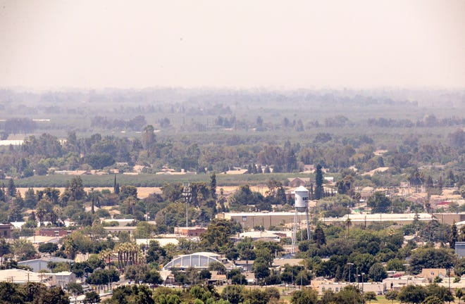 Poor air quality obscures the view of Exeter from the top of Rocky Hill on Monday, August 9, 2021.