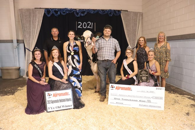 Taylor and Evan Schrauth, center, are the owners of Ryan-Vu Brady Drizzle, winner of the 5 year old division at the Agromatic Holstein Futurity at the Fond du Lac County Fair.  Joining them, back row from left, Agromatic representative, Brett Zickert; judge Krysty Kamps & trophy sponsor Rae Nell Halbur. Front row from left, Alice in Dairyland, Julia Nunes; 2021 FDL Co. Fairest of the Fair, Parker Schmitz; Wisconsin Holstein Princess, Zoe Ertl; and Wisconsin Holstein Princess Attendant, Emily Stumpf.