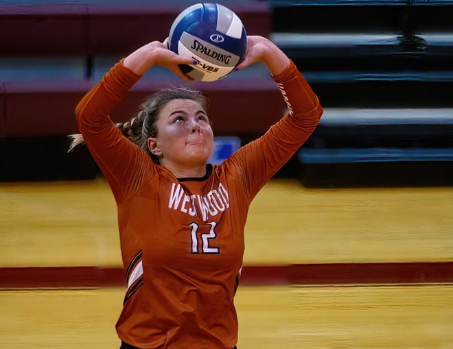 Westwood's Phia Parent sets the ball against Dripping Springs at the nondistrict volleyball game on Monday at Rouse High School. Parent impressed in her first appearance as the starting setter as Westwood beat the Tigers in three sets.