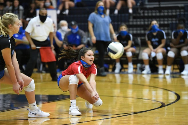 Cedar Creek's Karina Garcia reaches down for a dig during a match last season. Garcia and the Eagles hope to improve upon a 3-11 District 18-5A record this year.