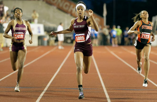 Bastrop's Glorilisha Carter, center, won the Girls Class 4A 200 meter race with a time of 24:59 at the 2014 state track and field meet. Carter was inducted into the Bastrop sports Hall of Fame Saturday.