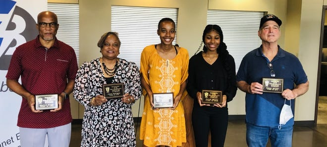 """Six former students were inducted into the Bastrop Athlete Hall of Fame. From left to right: Winfred Wright, Cynthia Washington for her husband Andrew, Glorilisha """"LeLe"""" Carter, Peniah Waites, and Mike Zglinski. Donald Sirles was not pictured."""