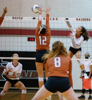 Rouse's Kayla Lopez, right, fires a shot as Westwood's Phia Parent tries to set up a block during the third set at the nondistrict volleyball game Monday at Rouse High School. Rouse beat Westwood and Dripping Springs in the triple-header between three of the area's top teams.