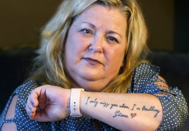 Brenda Ryan, founder of Keys to Serenity, shows a tattoo in honor of her daughter Sheena Moore, who died of an overdose on June 9, 2016.  Keys to Serenity helps other families dealing with losses caused by addiction.