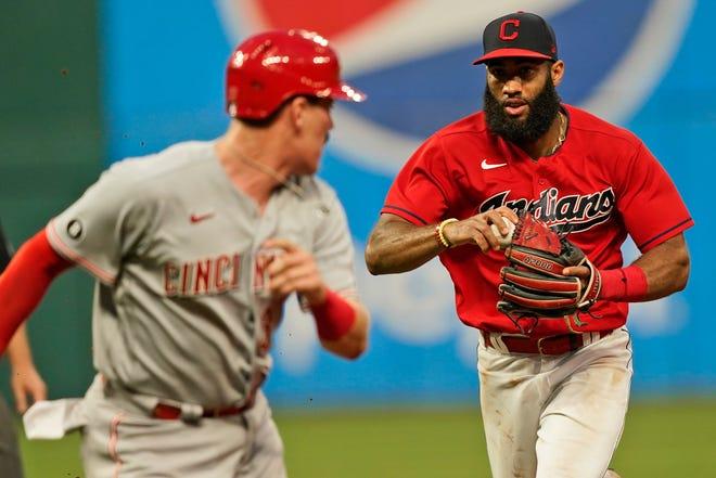 Cleveland shortstop Amed Rosario, right, runs down Cincinnati Reds first baseman Tyler Stephenson in the sixth inning of Cleveland's 9-3 win Monday night at Progressive Field. [Tony Dejak/Associated Press]