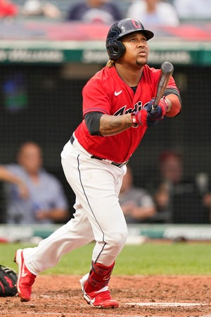 Cleveland third baseman Jose Ramirez watches his two-run home run in the fourth inning of a 9-3 win over the Cincinnati Reds on Monday night at Progressive Field. [Tony Dejak/Associated Press]