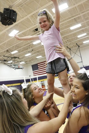 Kindergartner Everly Loya is lifted into the air by Early Longhorn cheerleaders (from left) Taylor Simpson, Joie Hyden, Lillie Brandstetter and Miranda Castanuela on Monday, Aug. 9, 2021, during the first day of little cheer camp in the Early High School gym. The two-day camp is for girls grades K-5.
