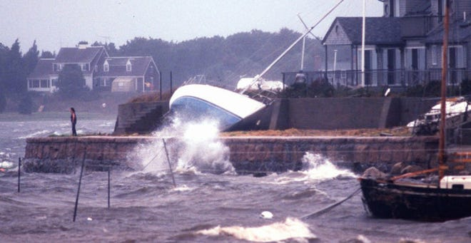 A beached sailboat on a sea wall in Monument Beach in Bourne during Hurricane Bob on Aug. 19, 1991.