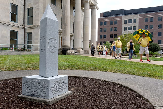 Columbia Chamber of Commerce Ambassadors and others walk toward the Boone County Bicentennial Monument on Tuesday following an indoor dedication at the Boone County Government Building. The monument commemorates the county's 200-year history.