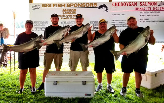Winning the 23rd Annual Cheboygan Salmon Tournament Boat Division title was Kingfisher II, captained by Tammy Dobrowolski. Members of the team in this photo include, from left, Tammy, Hunter, Tanner, Pete and Joe Dobrowolski.