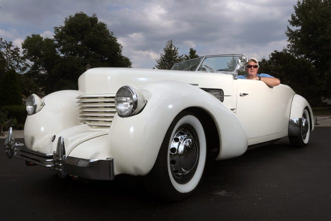 Keith Olszewski of Dublin sits inside his 1937 Cord Model 812 Phaeton supercharged convertible, which was previously owned and restored by his father, Leonard Olszewski.