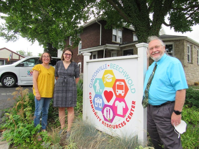 Bill Owens (right), Stephanie Baker and Katie Palmer stand in front of the headquarters of the Clintonville-Beechwold Community Resources Center, 3222 N. High St. in Columbus. The CRC is celebrating its 50th anniversary this year. Owens is executive director, Baker is associate director and Palmer is director of development.