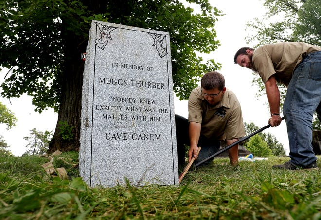 A statue of James Thurber's cantankerous family dog, Muggs, is finally going up in Green Lawn Cemetery. Workers prepped the location near Thurber's plot on Tuesday, August 10, 2021. Jay Biddle of the monument crew, left, and monument crew head Justin Shumway, right, level the base.