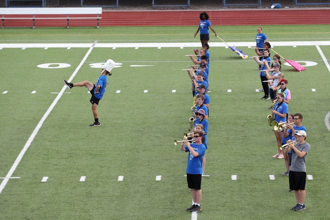 Gahanna Lincoln High School senior drum major Joshua Ford struts ahead of the marching band during band camp Aug. 6 at the school.