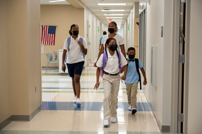 Kids look for their classroom on the first day of school at Lake Pointe Academy in Clermont. [Cindy Peterson/Correspondent]