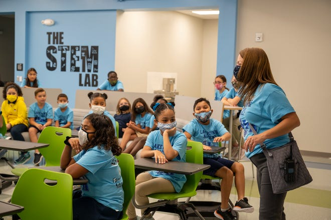 Principal Andrea Steenken visits the kids in the STEM Lab on the first day of school at Lake Pointe Academy in Clermont. [Cindy Peterson/Correspondent]