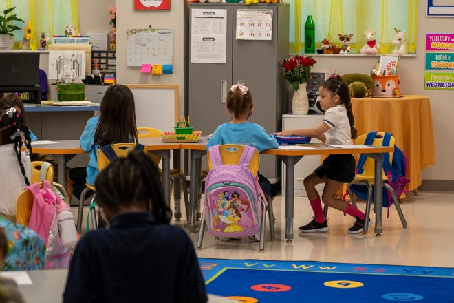 Kids sit at their desks on the first day of school  at Lake Pointe Academy in Clermont. [Cindy Peterson/Correspondent]