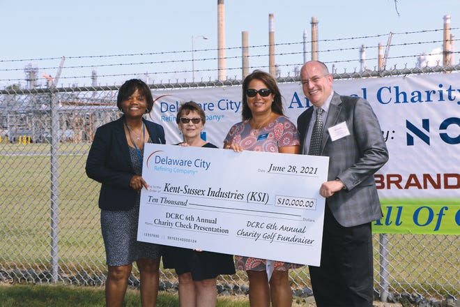 From left, Lisa Lindsey, Delaware City Refining Co. public affairs & community relations manager; Alicia Hollis, KSI's director of community relations; Ann Haggerty, KSI's vice president of mission advancement; and DCRC General Manager Michael Capone gather during DCRC's sixth annual charity check presentation ceremony to celebrate the $10,000 donation KSI received.
