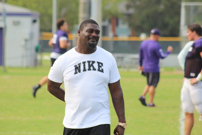 Fletcher head coach, Ciatrick Fason, looks on as players run sprints to close practice out.