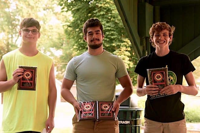 Orion High School wrestlers receiving awards on Wednesday, July 28, in Central Park are, from left, Ethan Moran, Sportsmanship; Josh Fair, MVP and Most Dedication, and Luke Moen, Most Improved. Not pictured is Phillip Dochterman, Coaches Award.