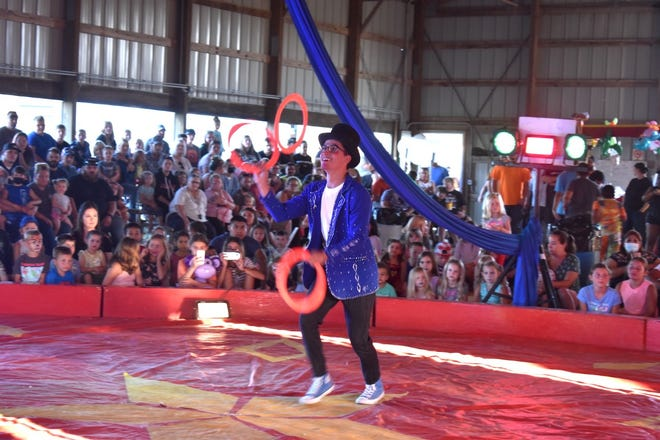 A juggler performs during the All American Circus on Tuesday, Aug. 3, in the beef show barn at the Henry County fairgrounds in Cambridge.