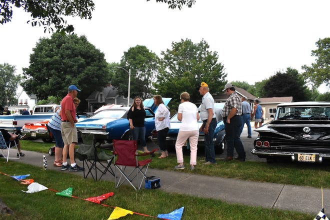 Cars lining Fifth Street draw a crowd during Main Street Orion's Cruise In to Orion on Saturday, Aug. 7.