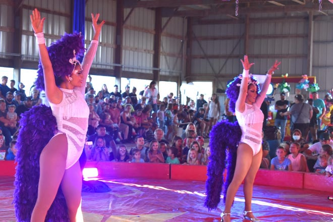The All American Circus performs on Tuesday, Aug. 3, for a full crowd in the beef show barn at the Henry County fairgrounds in Cambridge. Two dancers opened the performance.