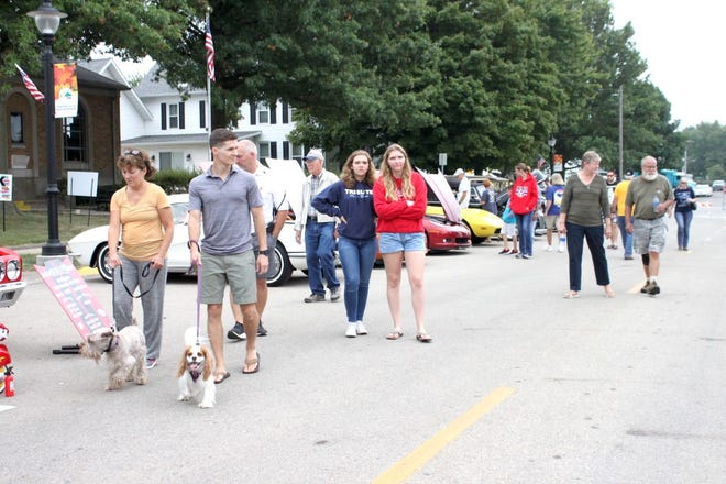 Spectators stroll through the 2019 Orion Fall Festival's car show on Fourth Street. This year's car show will be Sunday, Sept. 5, from noon to 4 p.m. Most of the cars will be on Fourth Street from 10th to 12th streets.