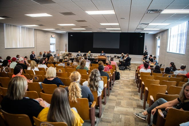 Families, community members, and medical professionals attended the Aug. 9 Henderson County Public Schools Board of Education meeting.