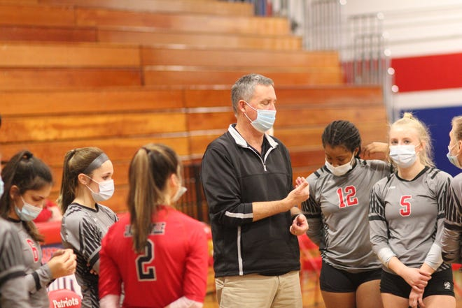 Jacksonville coach George Folger talks to his team during the Coastal 3-A Conference tournament final at West Carteret last season.