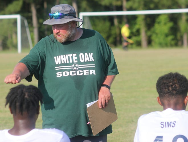 White Oak soccer coach Mike Larose talks to his team before the Vikings scrimmage Wallace-Rose Hill on Tuesday.