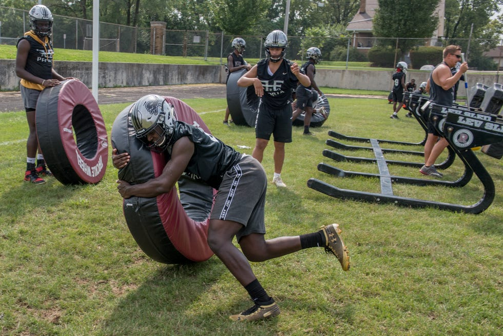 A Peoria High football player practices tackling on the official opening day of prep football practice Monday, Aug. 9, 2021 at Peoria High School.