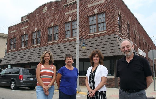 Liz Foley, from left, Nancy Heyen, Jessica Modica and Barry Treu stand Friday, Aug. 6, 2021, in front of what will be the new Freeport Art Museum in downtown Freeport.
