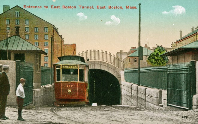 In this old postcard, people watch a Chelsea-bound streetcar come out of the East Boston Tunnel.