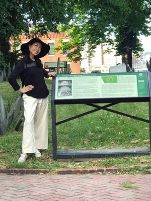 """Dr. Guan Li checks out the Copp's Hill Burying Ground in the North End. Established in 1659, it was originally named the """"North Burying Ground"""" and was the city's second cemetery."""