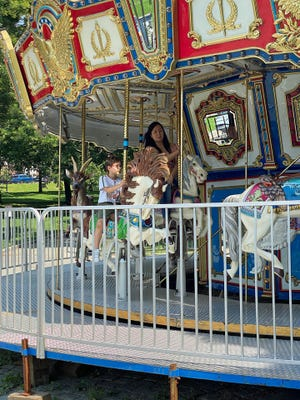 People of all ages enjoy riding on the carousel in Boston Common.