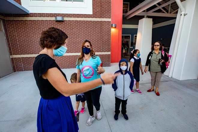 Principal Michelle Townley directs parents and students on the first day of school at the new Willow Oak Elementary school in Mulberry  Fl. Tuesday August 10 2021.  ERNST PETERS/ THE LEDGER