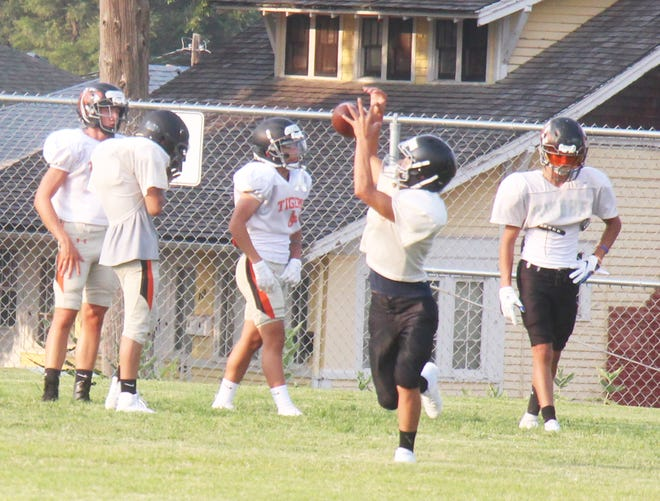 The La Junta High School football team goes through receiving drills on the first day of practice on Monday, Aug. 9, 2021.