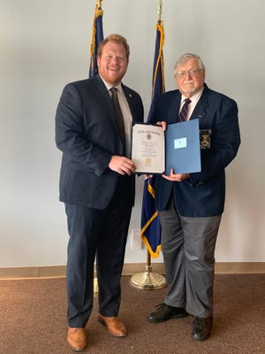 Assembly Member Josh Jensen, R-134th District, left, joins the legislative squadron of Civil Air Patrol's New York Wing. He received his membership certificate from Lt. Col. Terry LeFeber, deputy chief of staff.